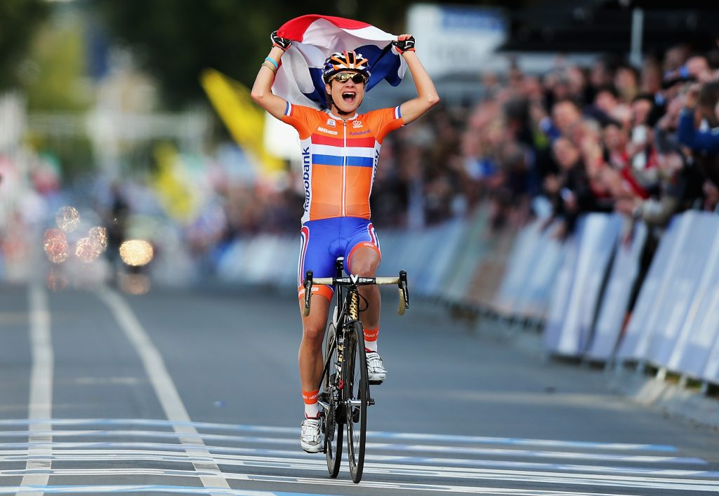 VALKENBURG, NETHERLANDS - SEPTEMBER 22: Marianne Vos of the Netherlands celebrates winning the Elite Women's Road Race on day seven of the UCI Road World Championships on September 22, 2012 in Valkenburg, Netherlands. (Photo by Bryn Lennon/Getty Images)